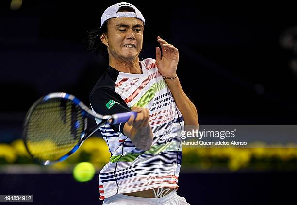 Taro Daniel of Japan in action against Guillermo GarciaLopez of Spain during day fourth of the ATP World Tour Valencia Open tennis tournament at the...
