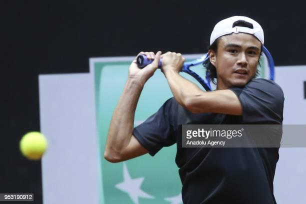 Taro Daniel of Japan in action against Matteo Berettini of Italia during the TEB BNP Paribas Istanbul Cup men's singles tennis match at the Garanti...