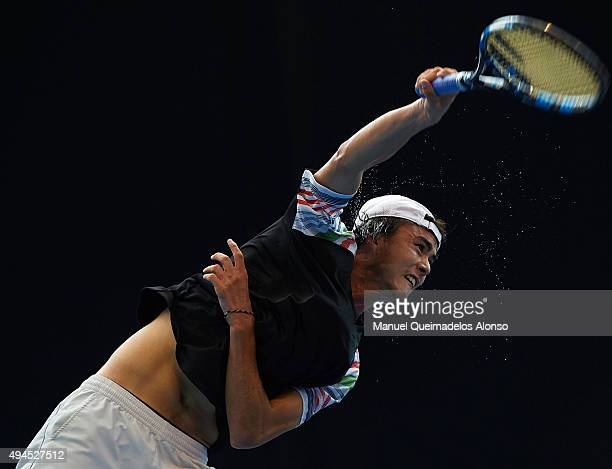 Taro Daniel of Japan in action against Michal Przysiezny of Poland during day two of the ATP World Tour Valencia Open tennis tournament at the Ciudad...