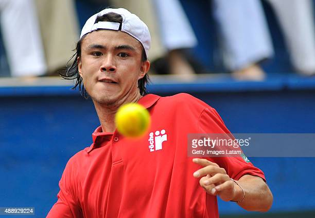 Taro Daniel of Japan in action during the Davis Cup World Group Playoff singles match between Santiago Giraldo of Colombia and Taro Daniel of Japan...