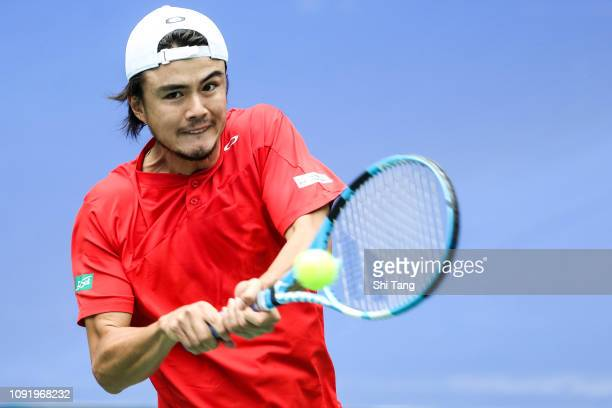 Taro Daniel of Japan in action in the Men's Singles match against Zhang Ze of China on day one at Guangdong Olympic Sports Center Tennis Center on...