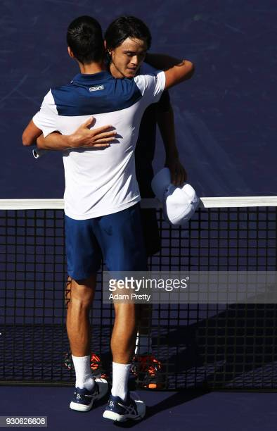 Taro Daniel of Japan is congratulated after winning his match against Novak Djokovic of Serbia during the BNP Paribas Open at the Indian Wells Tennis...