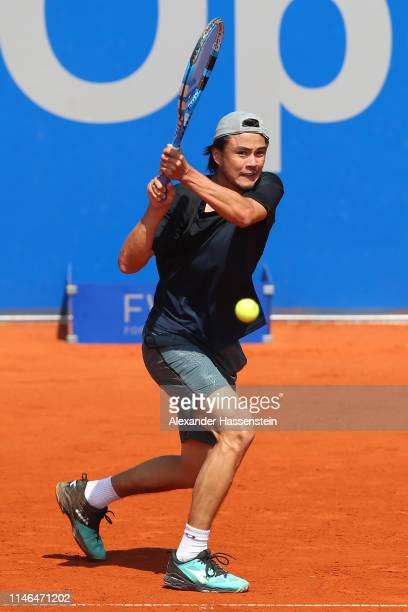 Taro Daniel of Japan plays a back hand during his second round match against Guido Pella of Argentina during day 6 of the BMW Open at MTTC IPHITOS on...