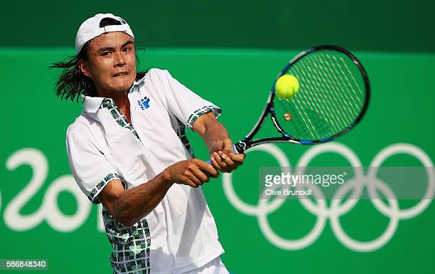 Taro Daniel of Japan plays a backhand against Jack Sock of the United States in their first round match on Day 1 of the Rio 2016 Olympic Games at the...