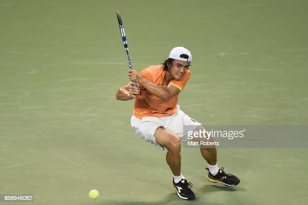 Taro Daniel of Japan plays a backhand against YenHsun Lu of Chinese Taipei during day two of the Rakuten Open at Ariake Coliseum on October 3 2017 in...
