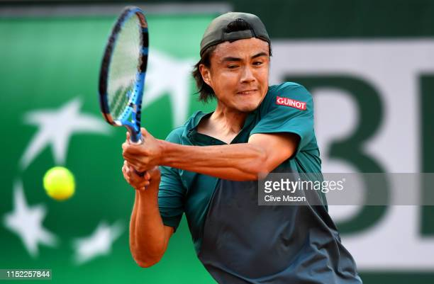 Taro Daniel of Japan plays a backhand during his mens singles first round match against Gael Monfils of France during Day three of the 2019 French...