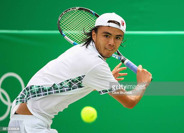 Taro Daniel of Japan plays a backhand during the Men's Singles second round match against Kyle Edmund of Great Britain on Day 3 of the Rio 2016...