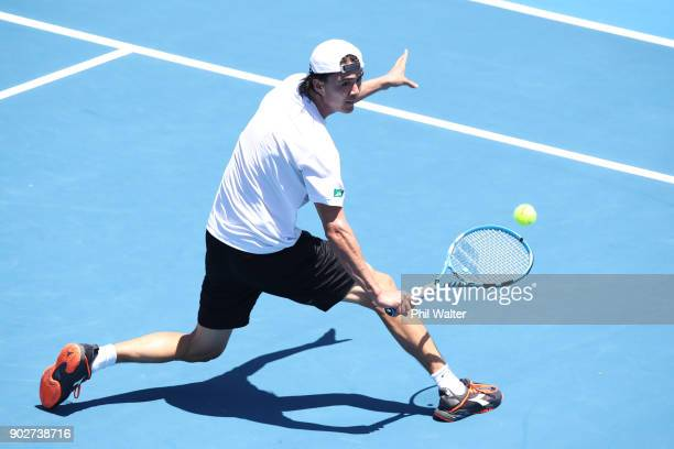 Taro Daniel of Japan plays a backhand in his first round match against Pablo Cuevas or Uruguay during day two of the ASB Men's Classic at ASB Tennis...