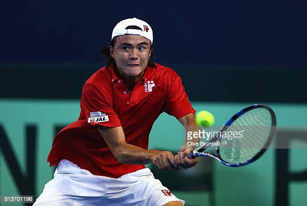 Taro Daniel of Japan plays a backhand in his singles match against Andy Murray of Great Britain during day one of the Davis Cup World Group first...