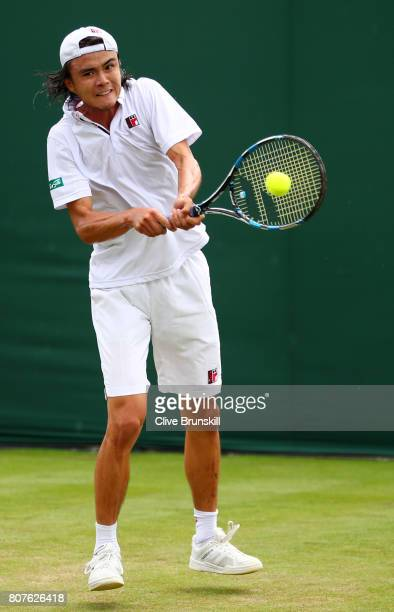 Taro Daniel of Japan plays a backhand shot during the Gentlemen's Singles first round match against Mikhail Kukushkin of Kazakhstan on day two of the...