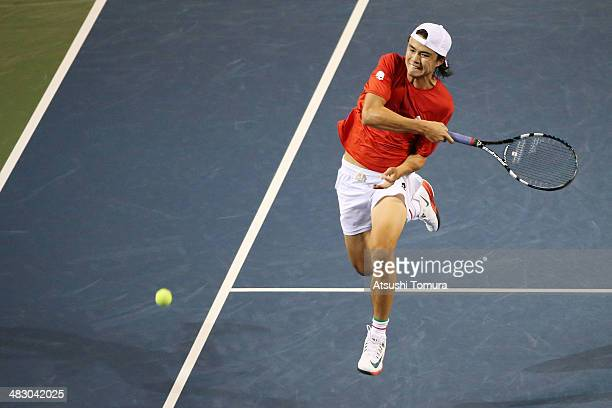 Taro Daniel of Japan plays a forehand during his match against Jiri Vesely of the Czech Republic during day three of the Davis Cup World Group...