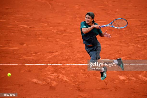 Taro Daniel of Japan plays a forehand during his mens singles first round match against Gael Monfils of France during Day three of the 2019 French...