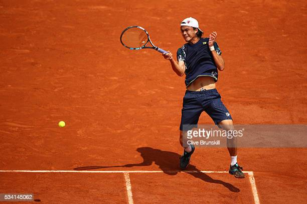 Taro Daniel of Japan plays a forehand during the Men's Singles second round match against Stan Wawrinka of Switzerland at Roland Garros on May 25...