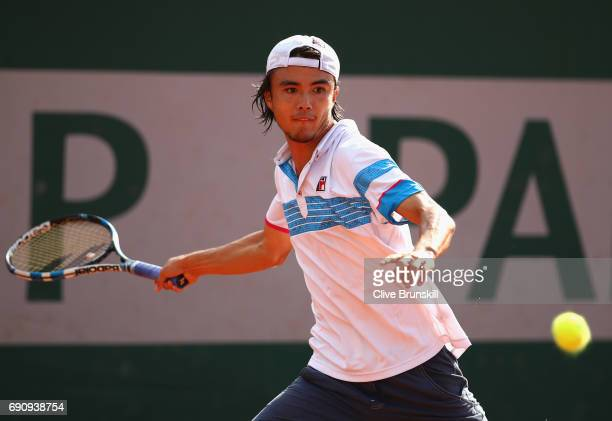Taro Daniel of Japan plays a forehand during the mens singles second round match against Pablo Carreno Busta of Spain on day four of the 2017 French...