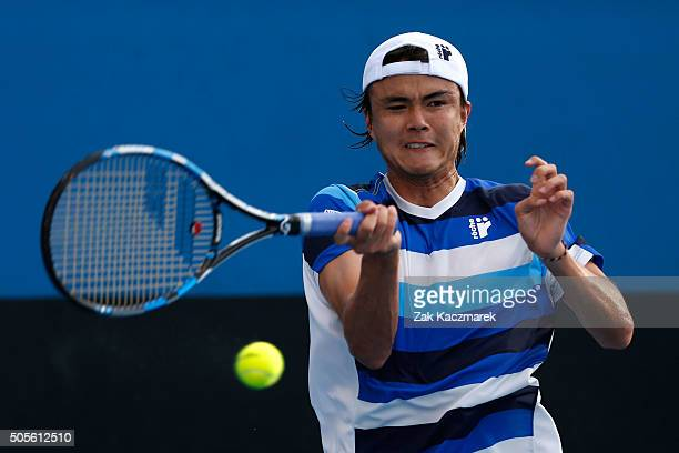 Taro Daniel of Japan plays a forehand in his first round match against Lukas Rosol of Czech Republic during day two of the 2016 Australian Open at...
