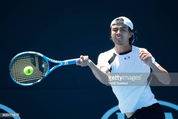 Taro Daniel of Japan plays a forehand in his first round match against Julien Benneteau of France on day two of the 2018 Australian Open at Melbourne...