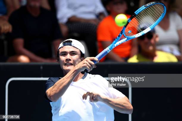 Taro Daniel of Japan plays a forehand in his first round match against Pablo Cuevas or Uruguay during day two of the ASB Men's Classic at ASB Tennis...