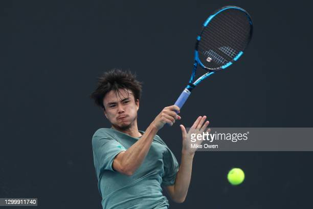 Taro Daniel of Japan plays a forehand in his match against Andrew Harris of Australia during day two of the ATP 250 Murray River Open at Melbourne...
