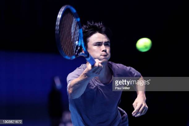 Taro Daniel of Japan plays a forehand in his Men's Singles second round match against Marin Cilic of Croatia on day three of the Singapore Tennis...
