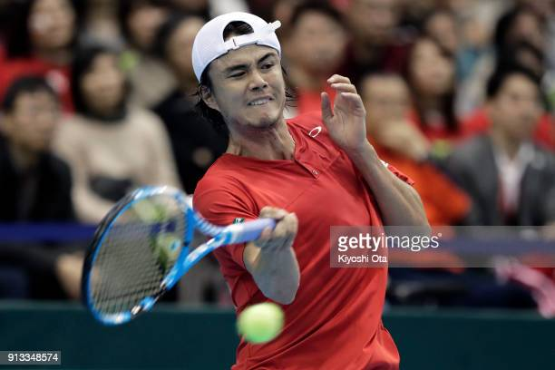 Taro Daniel of Japan plays a forehand in his singles match against Fabio Fognini of Italy during day one of the Davis Cup World Group first round...