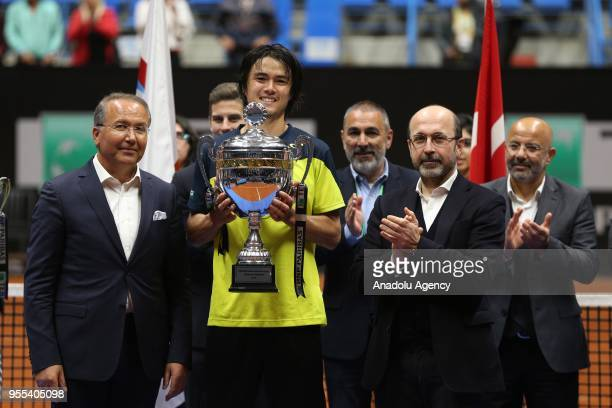 Taro Daniel of Japan poses with his winner trophy after TEB BNP Paribas Istanbul Open men's singles final match against Malek Jaziri of Tunisia at...