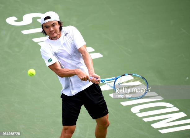 Taro Daniel of Japan prepares to his a backhand in his match against Leonardo Mayer of Argentina during the BNP Paribas Open at the Indian Wells...