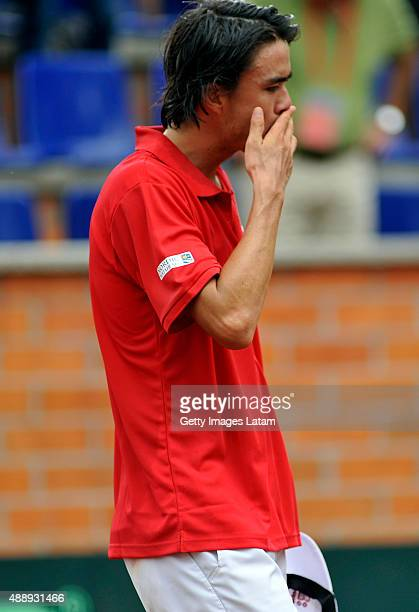 Taro Daniel of Japan reacts after losing the Davis Cup World Group Playoff singles match against Santiago Giraldo of Colombia at Club Campestre on...