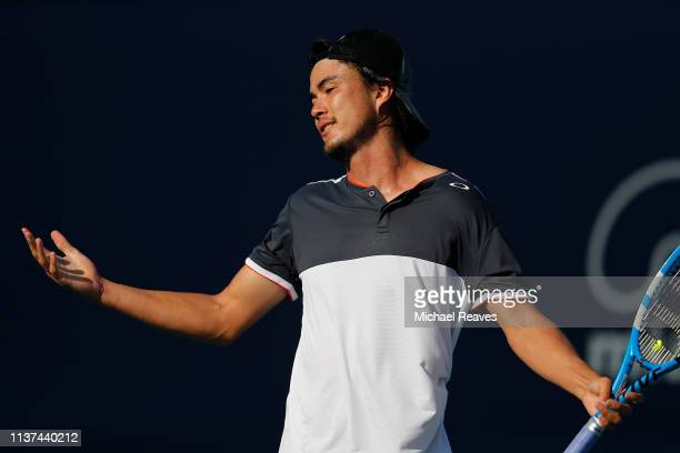 Taro Daniel of Japan reacts during his match against Andrey Rublev of Russia during Day 4 of the Miami Open Presented by Itau at Hard Rock Stadium on...