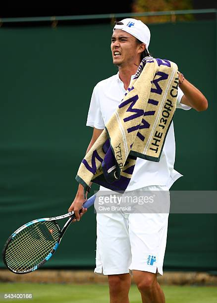Taro Daniel of Japan reacts during the Men's Singles first round match against Juan Monaco of Argentina on day two of the Wimbledon Lawn Tennis...