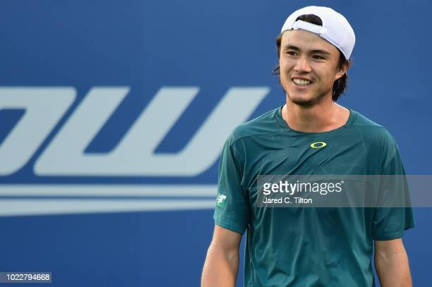 Taro Daniel of Japan reacts following a point against Daniil Medvedev of Russia during their semifinals match on day five of the WinstonSalem Open at...