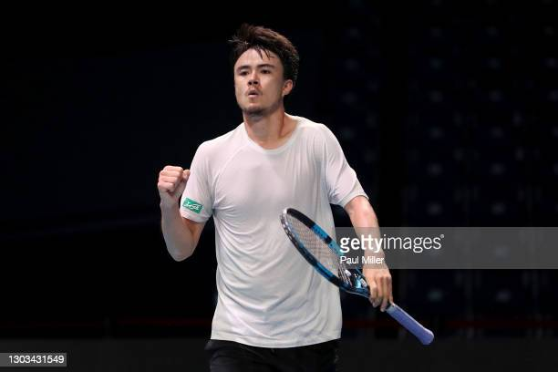 Taro Daniel of Japan reacts in his Men's Singles first round match against Ramkumar Ramanathan of India on day one of the Singapore Tennis Open at...