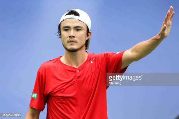 Taro Daniel of Japan reacts in the Men's Singles match against Li Zhe of China during day two of the 2019 Davis Cup Qualifiers at Guangdong Olympic...