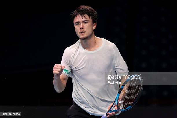 Taro Daniel of Japan reactsin his Men's Singles first round match against Ramkumar Ramanathan of India on day one of the Singapore Tennis Open at the...