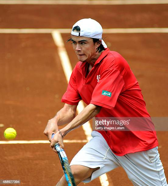 Taro Daniel of Japan returns a backhand shot during the Davis Cup World Group Playoff singles match between Santiago Giraldo of Colombia and Taro...