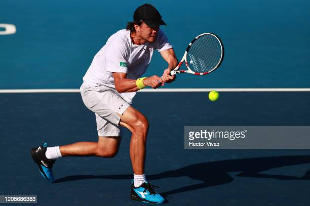 Taro Daniel of Japan returns a ball during the singles match between Taro Daniel of Japan and Soonwoo Kwon of South Korea as part of the ATP Mexican...