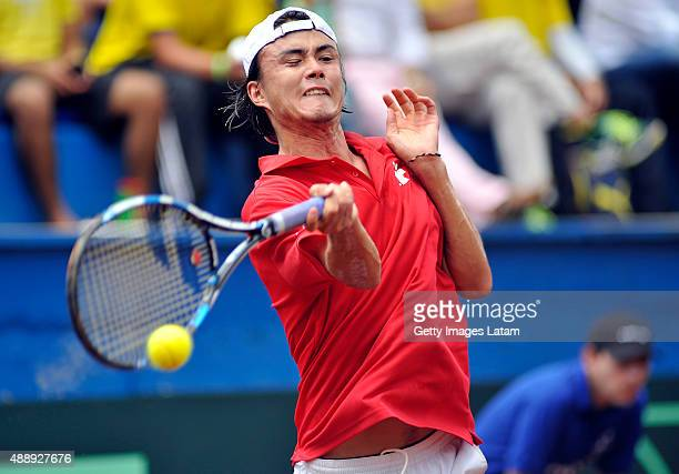 Taro Daniel of Japan returns a forehand shot during the Davis Cup World Group Playoff singles match between Santiago Giraldo of Colombia and Taro...