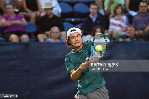 Taro Daniel of Japan returns a shot from Daniil Medvedev of Russia during their semifinals match on day five of the WinstonSalem Open at Wake Forest...