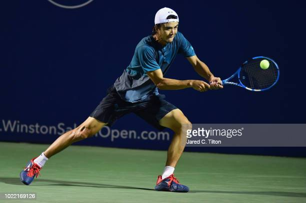 Taro Daniel of Japan returns a shot from Nicolas Jarry of Chile during their quarterfinals match on day four of the WinstonSalem Open at Wake Forest...