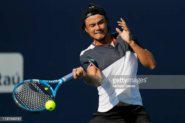 Taro Daniel of Japan returns a shot to Andrey Rublev of Russia during Day 4 of the Miami Open Presented by Itau at Hard Rock Stadium on March 21 2019...