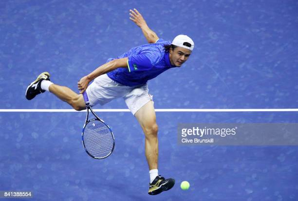 Taro Daniel of Japan returns a shot to Rafael Nadal of Spain in their second round Men's Singles match on Day Four of the 2017 US Open at the USTA...