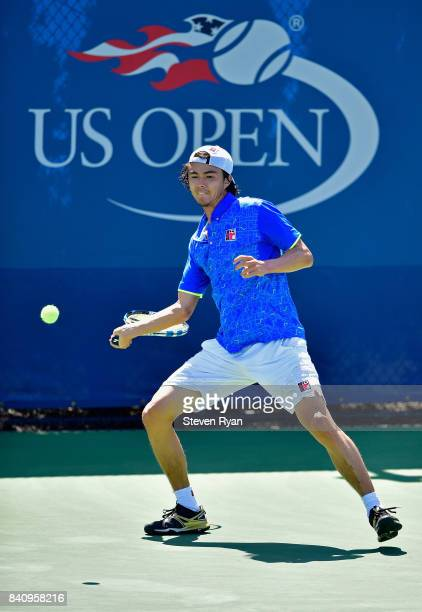 Taro Daniel of Japan returns a shot to Tommy Paul of the United States on Day Three of the 2017 US Open at the USTA Billie Jean King National Tennis...
