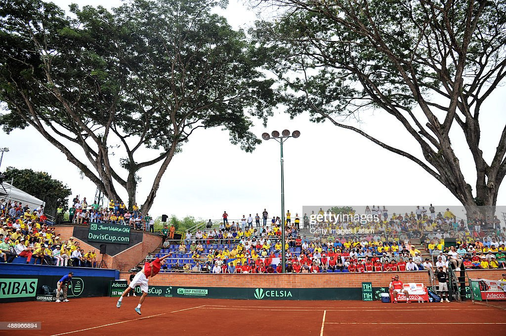 Taro Daniel of Japan servers a ball during the Davis Cup World Group Play-off singles match between Santiago Giraldo of Colombia and Taro Daniel of Japan at Club Campestre on September 18, 2015 in Pereira, Colombia.