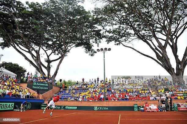 Taro Daniel of Japan servers a ball during the Davis Cup World Group Playoff singles match between Santiago Giraldo of Colombia and Taro Daniel of...
