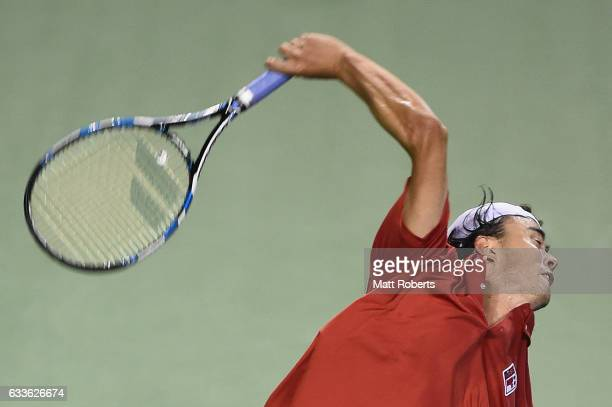 Taro Daniel of Japan serves against Richard Gasquet of France during the Davis Cup by BNP Paribas first round singles match between Japan and France...