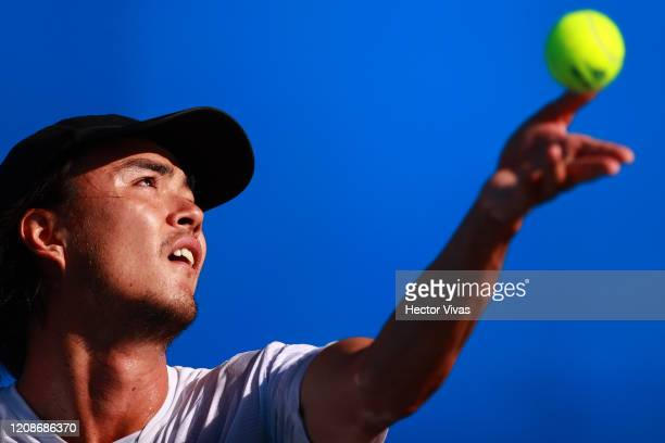 Taro Daniel of Japan serves during the singles match between Taro Daniel of Japan and Soonwoo Kwon of South Korea as part of the ATP Mexican Open...