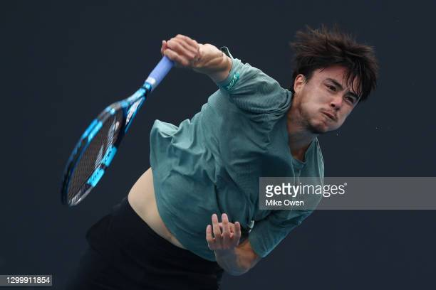 Taro Daniel of Japan serves in his match against Andrew Harris of Australia during day two of the ATP 250 Murray River Open at Melbourne Park on...