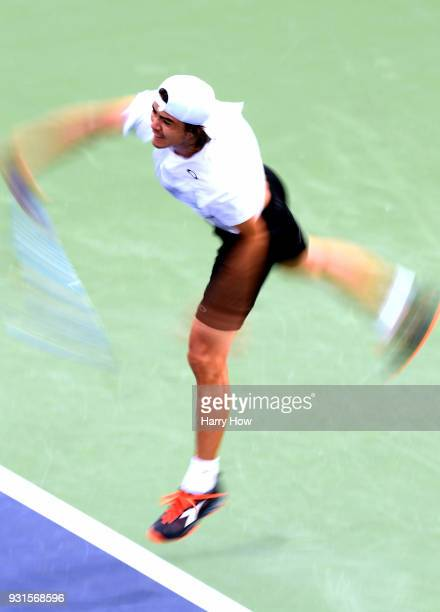 Taro Daniel of Japan serves in his match against Leonardo Mayer of Argentina during the BNP Paribas Open at the Indian Wells Tennis Garden on March...