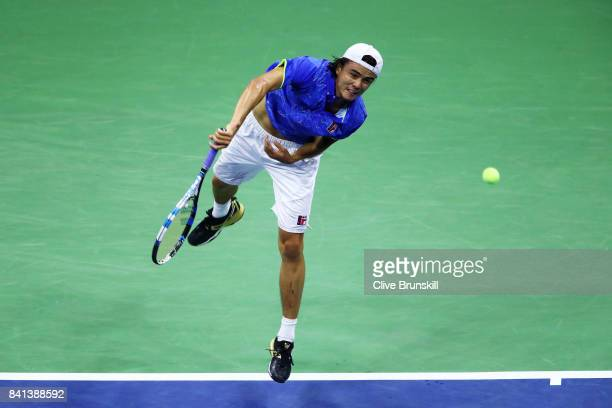 Taro Daniel of Japan serves to Rafael Nadal of Spain in their second round Men's Singles match on Day Four of the 2017 US Open at the USTA Billie...