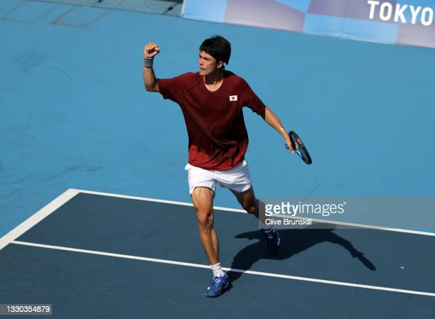 Taro Daniel of Team Japan celebrates after a point during his Men's Singles First Round match against Lorenzo Sonego of Team Italy on day one of the...