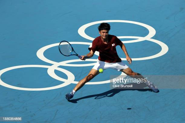 Taro Daniel of Team Japan plays a forehand during his Men's Singles First Round match against Lorenzo Sonego of Team Italy on day one of the Tokyo...